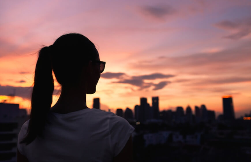 A woman looking at a sunset