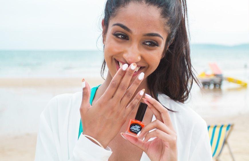 A woman enjoying Little Ondine peelable nail polish