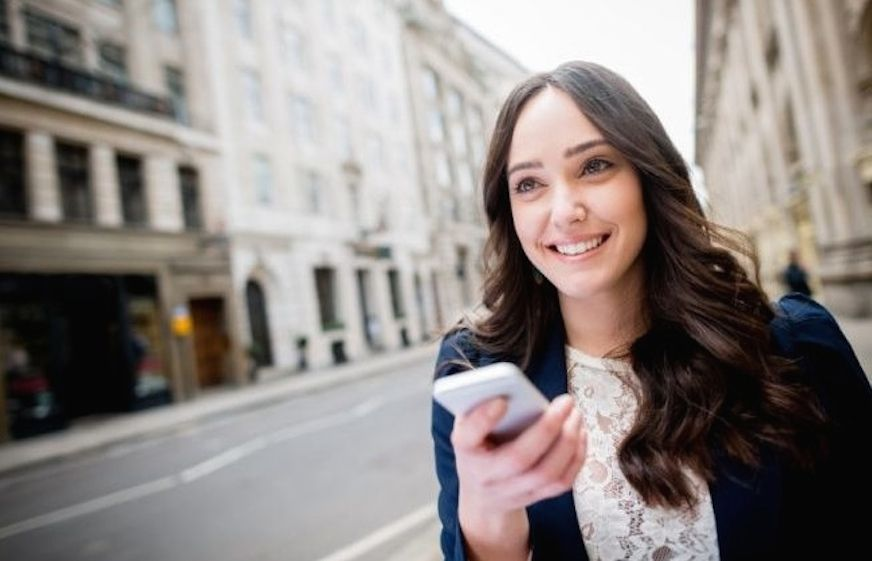 Woman using the Cabbygo taxi booking app