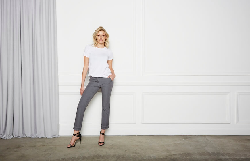A woman modeling Aella Cigarette Pants in gray