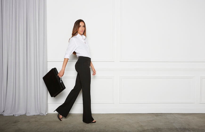 A woman wearing Aella High Waist Flares for work