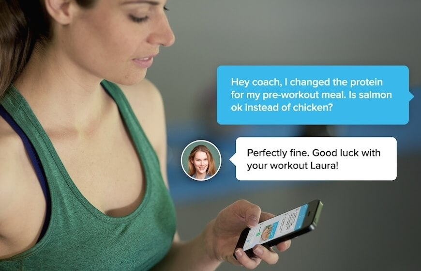 Woman connecting with her personal trainer on the Fitmo app