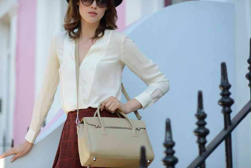 A woman with a Jardine of London handbag in camel