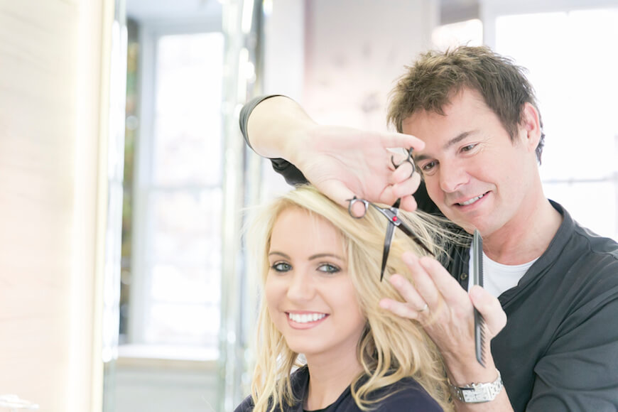 The hairdresser Richard Ward cutting and styling a client's hair
