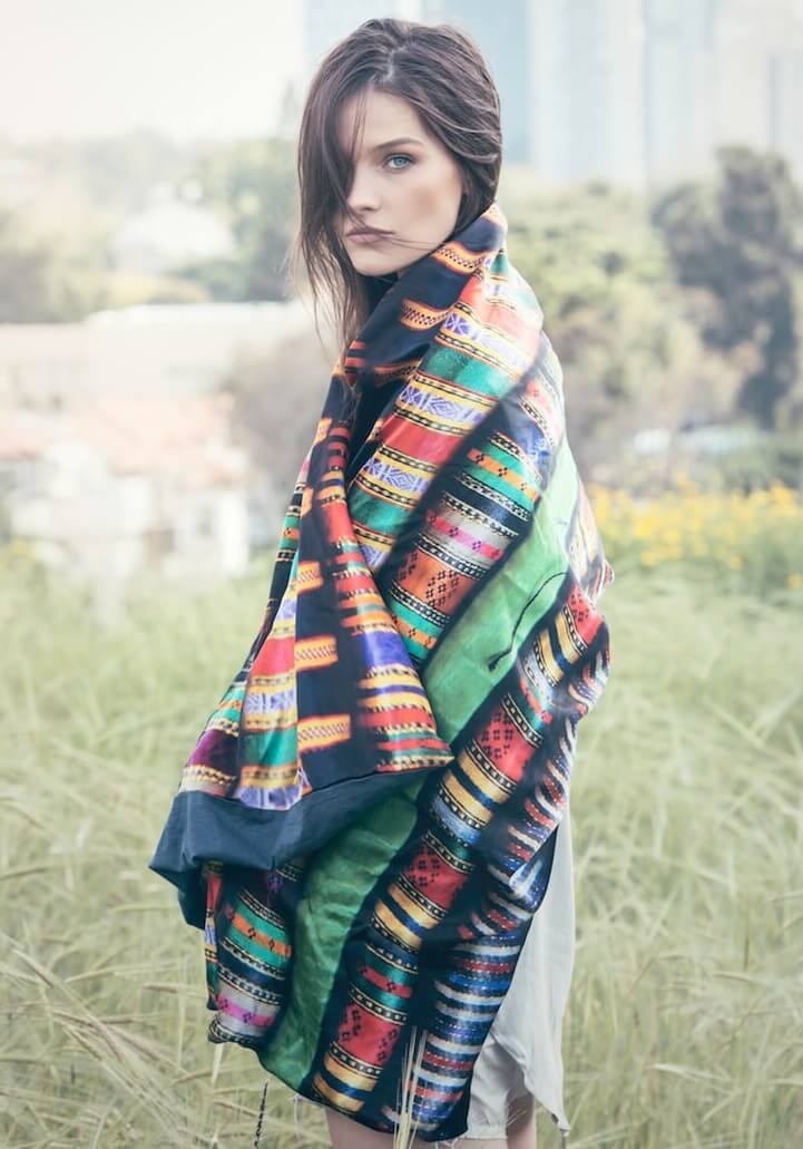A woman wearing the Damascus Silk scarf by Celia Gould